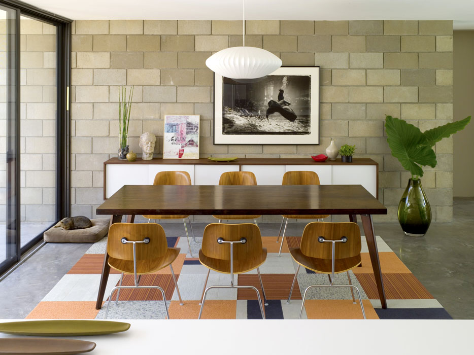 Pendant light above wooden dining table and chairs